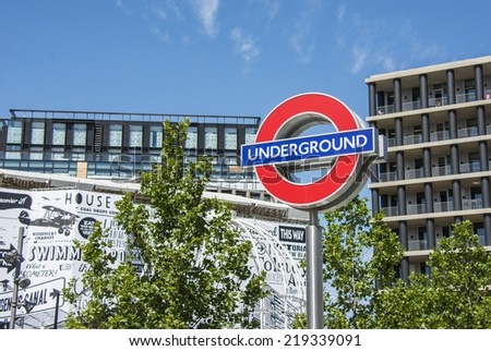 London, England - July 29th 2014: London underground sign outside Kings cross station.