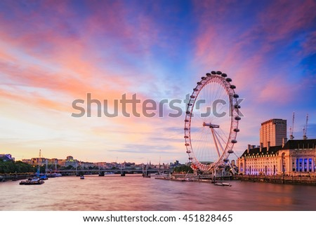 LONDON, ENGLAND - JULY 08, 2016. View of City Of London at sunset with London Eye the biggest attraction in London. - stock photo