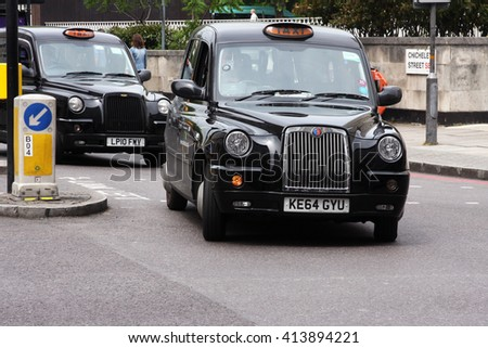 LONDON, ENGLAND - JUNE 12, 2015: A London Taxi or 'Black Cab' TX4 near Chicheley Street. The TX4 is a purpose-built taxicab (hackney carriage) manufactured by The London Taxi Company. - stock photo