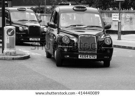 LONDON, ENGLAND - JUNE 12, 2015: A London Taxi or 'Black Cab' TX4 near Chicheley Street. The TX4 is a purpose-built taxicab (hackney carriage) manufactured by The London Taxi Company. Image is B&W. - stock photo