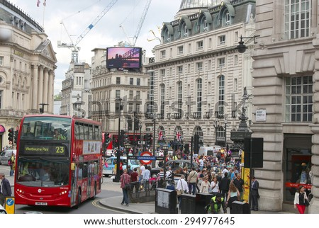 LONDON,ENGLAND,June 17, 2015: Busy streets with people and traffic in Piccadilly  Circus area in London, England in June 17, 2015 - stock photo