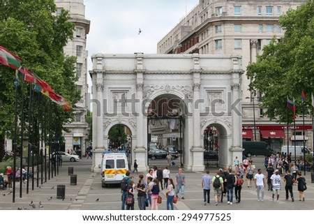 LONDON,ENGLAND,June 18. 2015: People walking and standing around the Marble Arch in London England, June 18, 2015 - stock photo