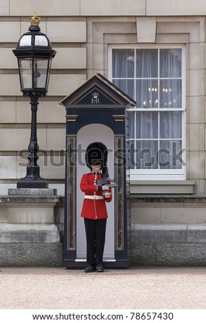 LONDON, ENGLAND- JUNE 21: Sentry of the Grenadier Guards posted outside of Buckingham Palace on June 21, 2009 in London, United Kingdom. The Grenadier Guards traces its lineage back to 1656. - stock photo