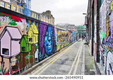LONDON, ENGLAND -12 MARCH 2015- Editorial: Painted walls and graffiti art are scattered in the Old Street, Brick Lane and Shoreditch area in East London in the heart of Banglatown. - stock photo