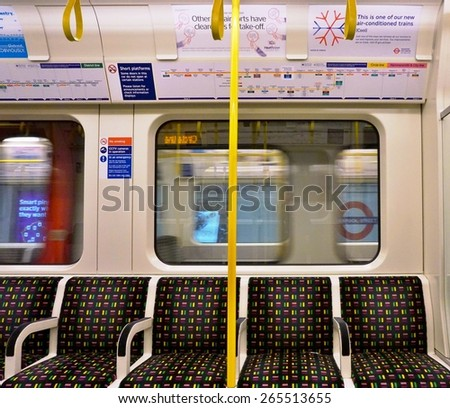 LONDON, ENGLAND -12 MARCH 2015- Editorial: The London Underground (familiarly called the Tube) is a public transit system serving 270 stations in greater London. Passengers pay with the Oyster card. - stock photo