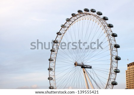 LONDON, ENGLAND - MARCH 15: London Eye on March 15th, 2013 in London. The 135 meter landmark is a giant Ferris wheel situated on the banks of the River Thames in London, England. - stock photo