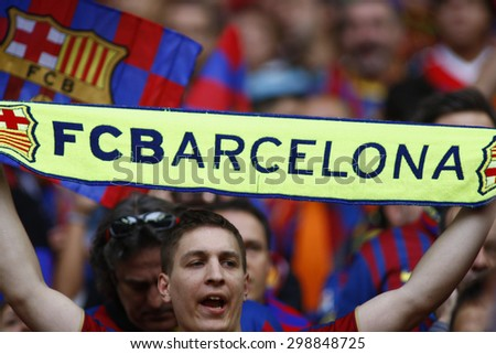 LONDON, ENGLAND. May 28 2011: A fan with a Barcelona scarf during the 2011UEFA Champions League final between Manchester United and FC Barcelona, at Wembley Stadium - stock photo