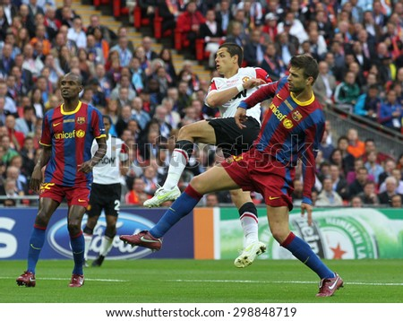 LONDON, ENGLAND. May 28 2011: Barcelona's Abidal. Manchester's Javier Hernandez and Barcelona's Gerard Pique during the 2011UEFA Champions League final between Manchester United and FC Barcelona - stock photo