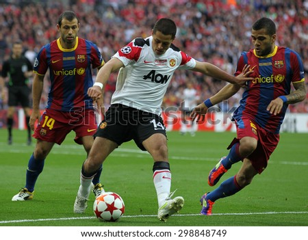 LONDON, ENGLAND. May 28 2011: Javier Mascherano, Manchester's Javier Hernandez and Barcelona's Daniel Alves during the 2011UEFA Champions League final between Manchester United and FC Barcelona - stock photo