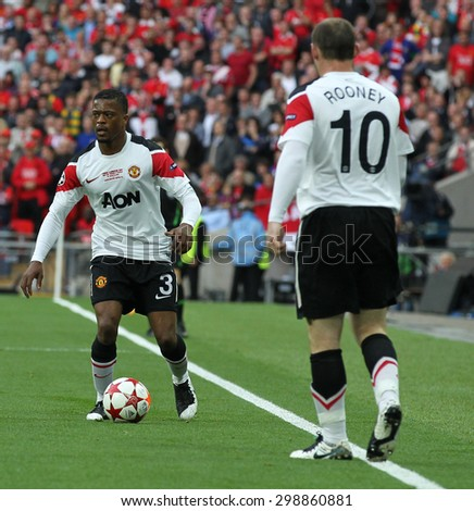 LONDON, ENGLAND. May 28 2011: Manchester's defender Patrice Evra and Manchester's forward Wayne Rooney during the 2011UEFA Champions League final between Manchester United and FC Barcelona - stock photo