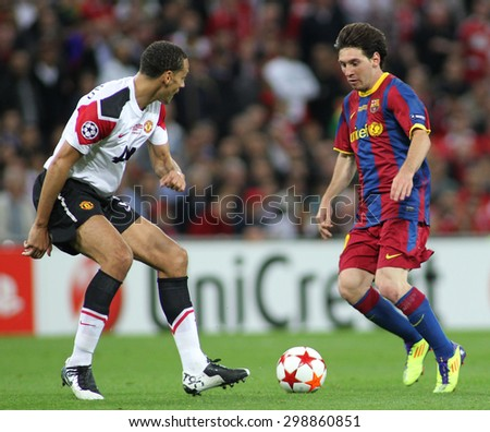 LONDON, ENGLAND. May 28 2011: Manchester's defender Rio Ferdinand and Barcelona's forward Lionel Messi during the 2011 UEFA Champions League final between Manchester United and FC Barcelona - stock photo