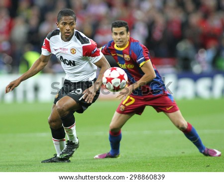 LONDON, ENGLAND. May 28 2011: Manchester's midfielder Antonio Valencia and Barcelona's midfielder Pedro Rodreguez during the 2011UEFA Champions League final between Manchester United and FC Barcelona - stock photo