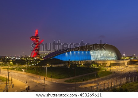 London, England - May 27, 2016: Night view of the illuminated London Aquatics Centre, Olympic stadium and ArcelorMittal Orbit observation tower in the Olympic Park of London, England.