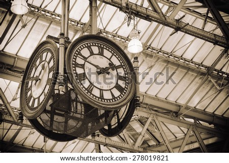 "London, England, May 11th, 2015,  A large four-faced clock hangs in the middle of the main concourse. ""Meeting ""under the clock"" is a traditional rendezvous point. - stock photo"