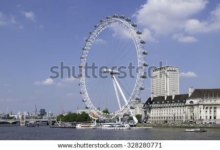 LONDON, ENGLAND - MAY 18, 2014: The London Eye is a giant Ferris wheel on the South Bank of the River Thames in London. It is the most popular paid tourist attraction with over 3.75 million visitors.