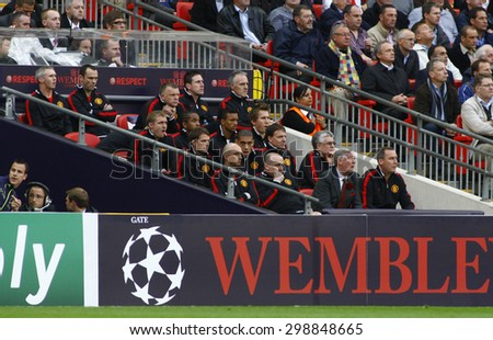 LONDON, ENGLAND. May 28 2011: The Manchester team bench during the 2011UEFA Champions League final between Manchester United and FC Barcelona, at Wembley Stadium - stock photo
