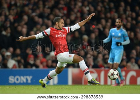 LONDON, ENGLAND - Nov 26 2013: Arsenal's Theo Walcott during the UEFA Champions League match between Arsenal and Olympique de Marseille, at The Emirates Stadium - stock photo