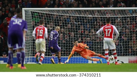 LONDON, ENGLAND - NOV 04 2014: Nathan Kabasele of Anderlecht scores a penalty  during the UEFA Champions League match between Arsenal and Anderlecht from Belgium played at The Emirates Stadium. - stock photo