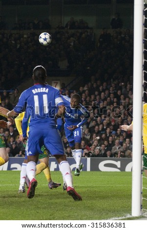 LONDON ENGLAND 23 NOVEMBER 2010. Chelsea's forward Salomon Kalou (21) heads the ball into the penalty area during the UEFA Champions League match between Chelsea FC and MSK Zilina - stock photo