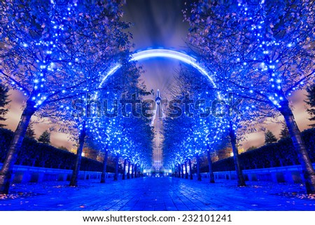 LONDON, ENGLAND - November 18: London Eye on November 18 2014 in London. The 135 meter landmark is a giant Ferris wheel situated on the banks of the River Thames in London, England. Long Exposure - stock photo