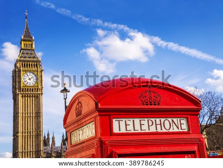 London, England - Old Red Telephone box and Big Ben with blue sky - United Kingdom - stock photo