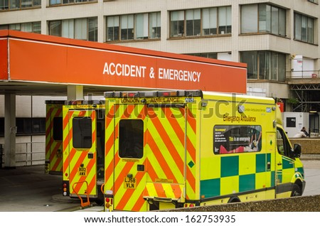 LONDON, ENGLAND - SEPTEMBER 21: Ambulances outside the Accident and Emergency entrance of St Thomas' Hospital in central London on September 21, 2013.  Pressure on the NHS is increasing this winter. - stock photo