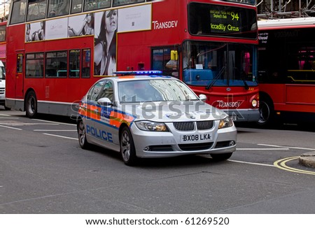 LONDON, ENGLAND - SEPTEMBER 15: Police car with blue lights answering emergency call in London on 15 September 2010. - stock photo