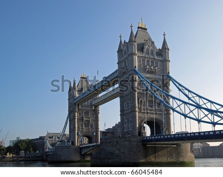 LONDON, ENGLAND - SEPTEMBER 26, 2009: Tower Bridge looking toward South Tower on September 26, 2009, with clear blue sky and with Tower of London in background. - stock photo