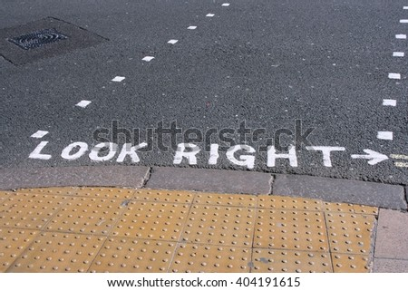 "London, England - typical ""look right"" street sign to remind pedestrians of traffic - stock photo"