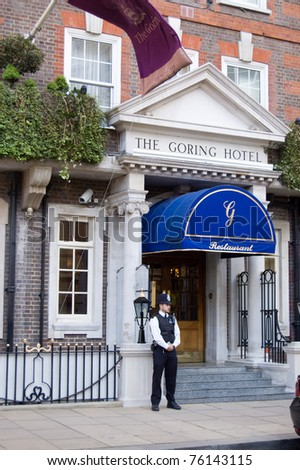 LONDON, ENGLAND, UK - APRIL 27: A police constable guards the Goring Hotel on April 27, 2011 in Belgravia, London, England, UK.  Kate Middleton is to spend her last night here before marrying Prince William. - stock photo