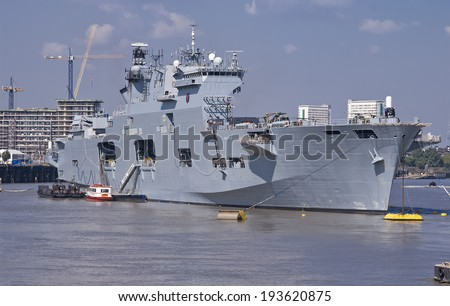 London, England, UK - August 8, 2012: Britain's helicopter carrier HMS Ocean, the Royal Navy's largest in the fleet, anchored on the River Thames along side Greenwich during the Olympic Games in 2012. - stock photo