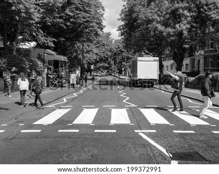 LONDON, ENGLAND, UK - JUNE 18: Abbey Road zebra crossing made famous by the 1969 Beatles album cover on June 18, 2011 in London, England, UK - stock photo