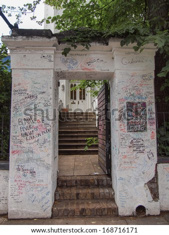 LONDON, ENGLAND, UK - JUNE 18, 2011: Graffiti by Beatles fans on the wall of the Abbey Road studios where the homonymous album was recorded in 1969 - stock photo