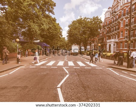 LONDON, ENGLAND, UK - JUNE 18: People crossing the Abbey Road zebra crossing made famous by the 1969 Beatles album cover on June 18, 2011 in London, England, UK vintage - stock photo
