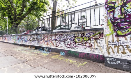 LONDON, ENGLAND, UK - MAY 24, 2013: Graffiti by Beatles fans on the wall of the Abbey Road studios where the homonymous album was recorded in 1969  - stock photo