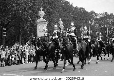 LONDON, ENGLAND, UK - MAY 5, 2014: Royal Guards during traditional Changing of the Guards ceremony near Buckingham Palace. This ceremony is one of the most popular tourist attractions in London. - stock photo