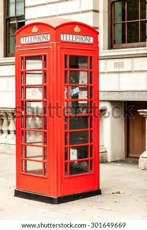LONDON, ENGLAND UK - SEPTEMBER 20, 2014: traditional old style red telephone box, british phone booth on September 20, 2014, England UK. - stock photo