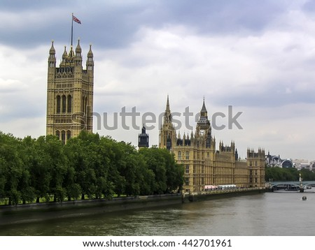 London, England, United Kingdom, Europe - June 29, 2004: The Victoria Tower, part of the Palace of Westmister and Thames river