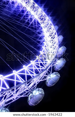 London Eye abstract original shot with star filter to create beautiful night time glow - stock photo
