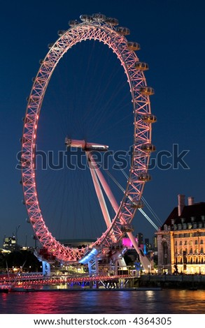 London Eye at the evening in London with reflection on water - stock photo