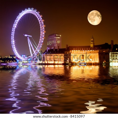 London Eye - dramatic night shot with full moon rising over the Thames - stock photo