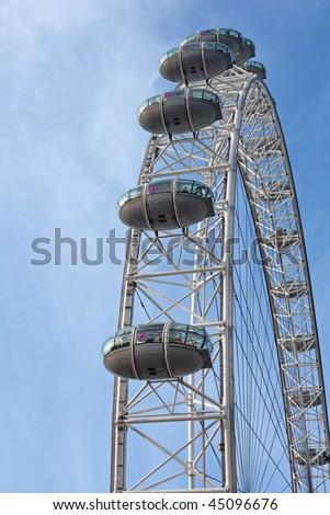 London eye: New London Landmark against blue sky - stock photo