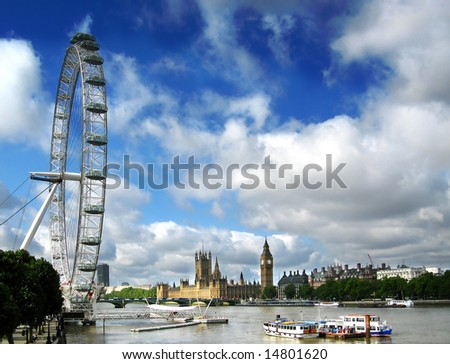 London Eye on the river Thames and Houses Of Parliment - stock photo