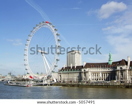 London Eye on the Thames River in London England.