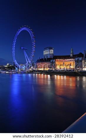London Eye vertical - viewed from Westminster Bridge - stock photo