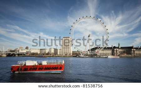 London Eye, view from opposite shore front - stock photo