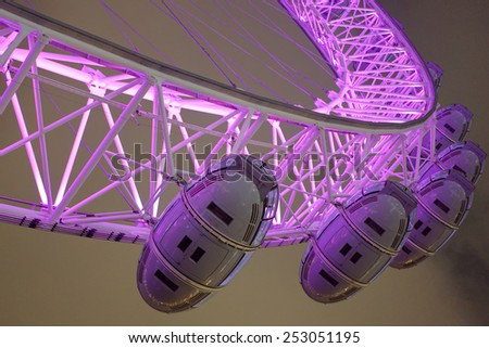 LONDON - FEB 14 : The London Eye Ferris wheel pictured at night on February 14th, 2015, in London, UK. Built in 1999, 135m tall and diameter of 120m, it is the tallest Ferris wheel in Europe.  - stock photo