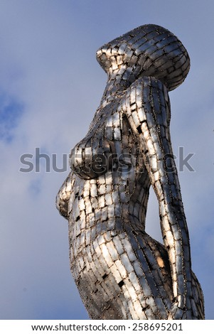 LONDON - FEBRUARY 16, 2015. Figurehead is a reflective steel sculpture by Rick Kirby, commissioned by St George plc, overlooking the River Thames at Fulham Reach, Hammersmith, London, UK. - stock photo