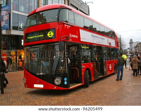 LONDON - FEBRUARY 27: The much heralded hybrid  'New Bus For London' started service on route 38. It is 50% more fuel efficient than existing diesel buses. February 27, 2012. - stock photo
