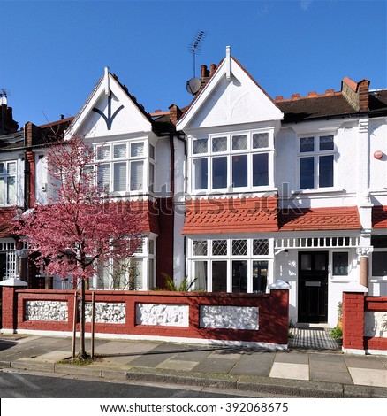LONDON - FEBRUARY 16, 2016. Typical small Edwardian period terraced houses built in 1913 at Rosedew Road on the Crabtree Estate, in the Borough of Hammersmith & Fulham, west London. - stock photo